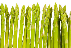 Fresh green asparagus isolated on a white background